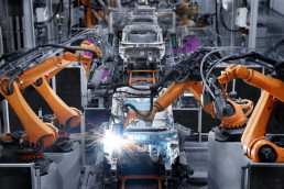 Machines in an automobile manufacturing plant