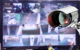 cctv security camera monitoring a building with screens
