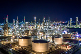 Aerial,View,Oil,And,Gas,Tank,With,Oil,Refinery,Background