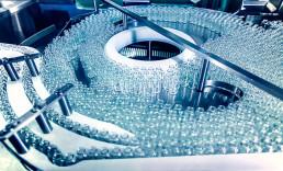 Pharmaceutical glass bottles on conveyor